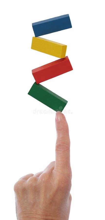 Bloques de equilibrio de la mano en el dedo foto de archivo libre de regalías