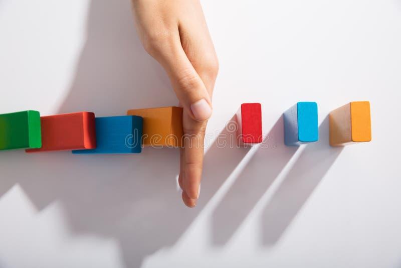 Bloques de Hand Stopping Colorful del empresario de caer imagen de archivo libre de regalías