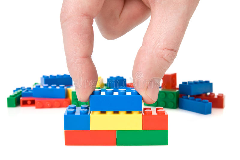 Bloques de la mano y del juguete imagen de archivo libre de regalías