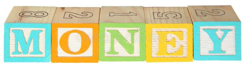 Bloques del alfabeto del dinero fotografía de archivo