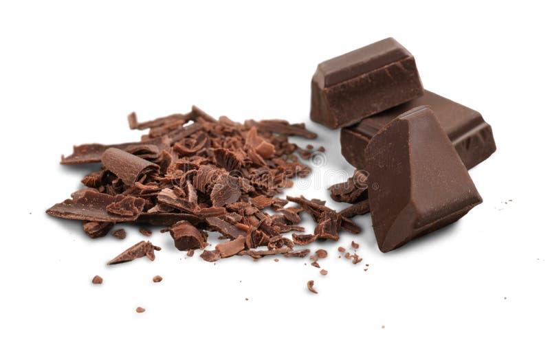 Bloques y pedazos del chocolate con leche imagen de archivo