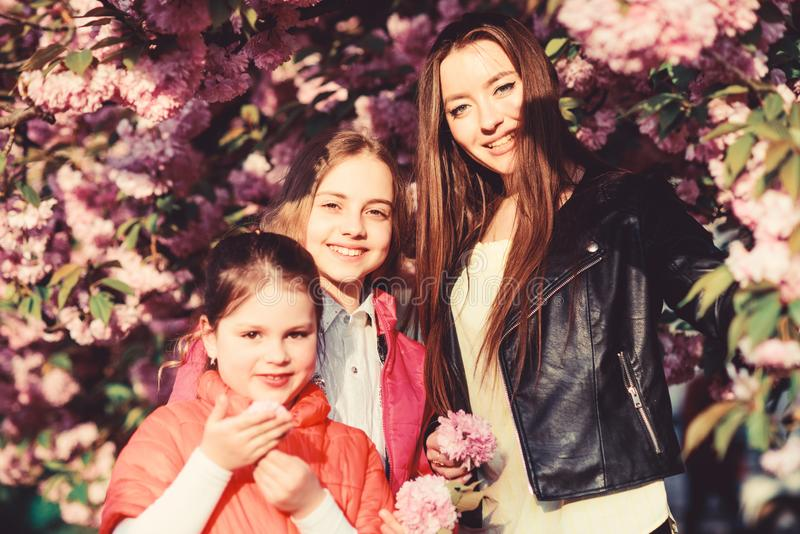 Blossom smell, allergy. Sisterhood. Natural beauty. Mothers day. happy sisters in cherry flower. Sakura bloom. family royalty free stock photography