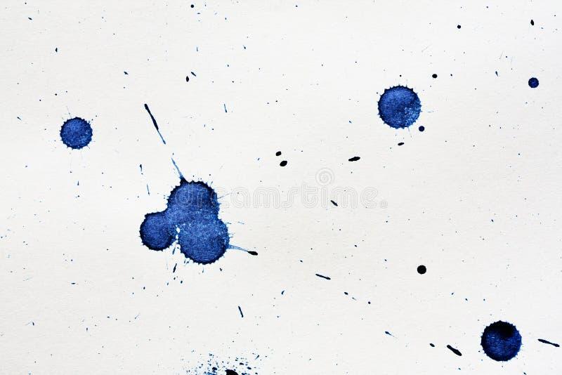 Blot. Ink blot on a textured paper stock photos