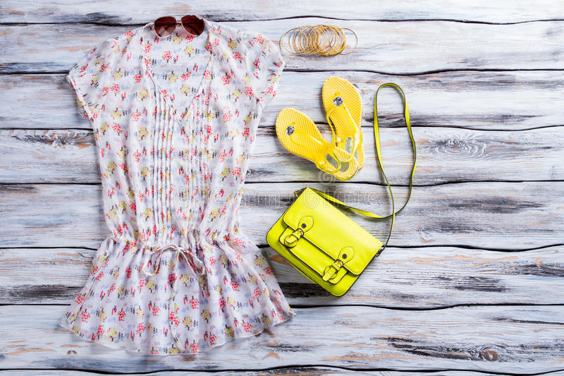Blouse, flip flops and purse. Light blouse and lime bag. Woman's outfit with bright accessory. Summer apparel at low price royalty free stock photography
