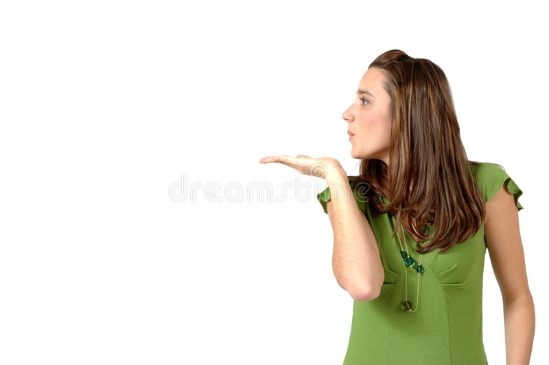 Blow. Woman looks to her side and blows a kiss over her empty hand. Sell a product here image stock photos