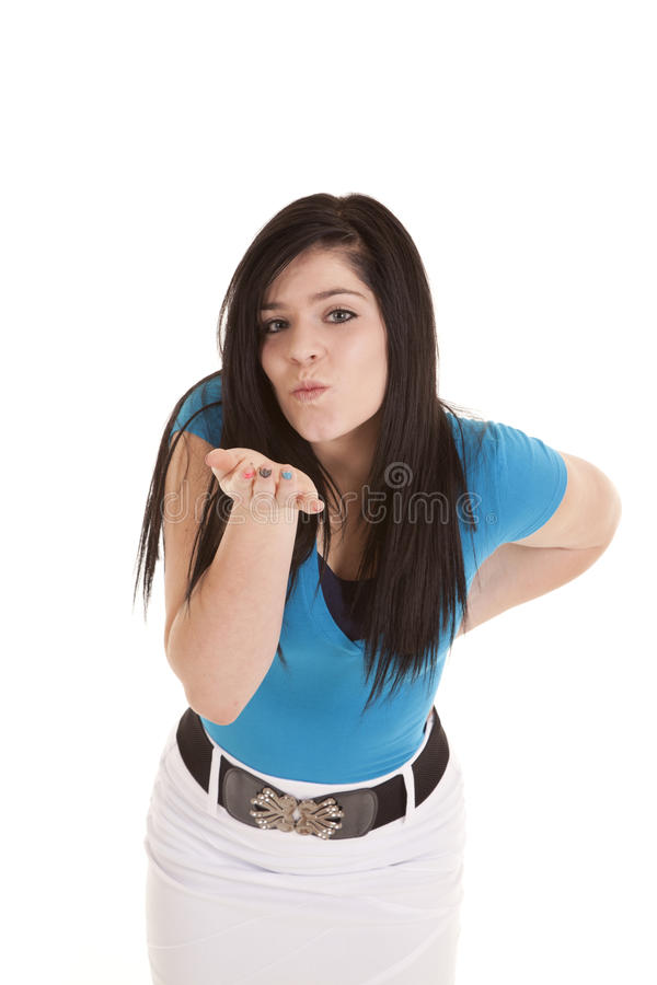 Blow kiss. A teen girl blowing a kiss to the camera royalty free stock photo