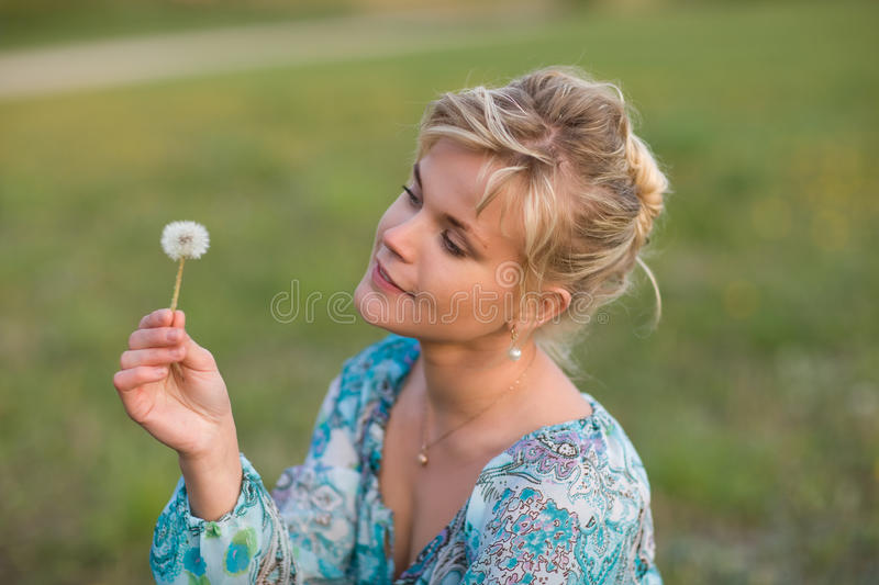 Download Blow for luck stock image. Image of face, caucasian, lawn - 13118469