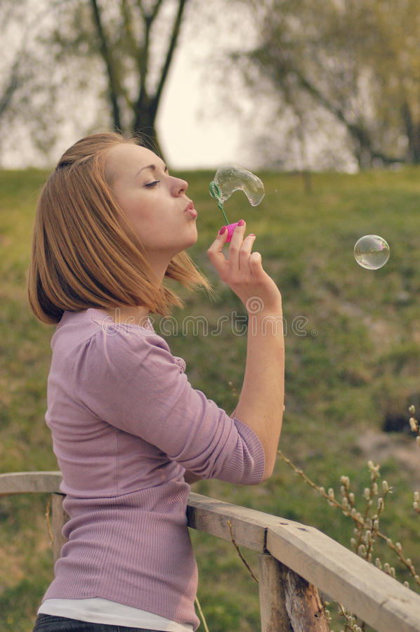 Blow soap bubbles stock photos