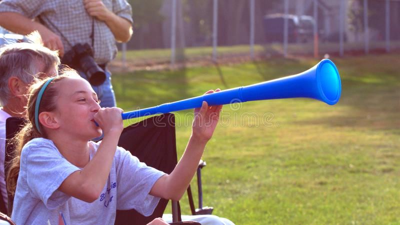 Blow your horn, girl! royalty free stock photos