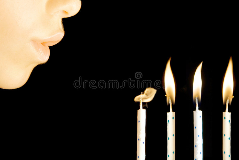Blowing birthday candles. Child blowing birthday celebration candles royalty free stock photos