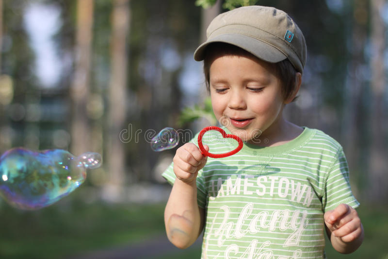 Blowing bubbles royalty free stock photo