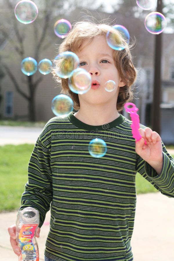 Blowing bubbles stock images