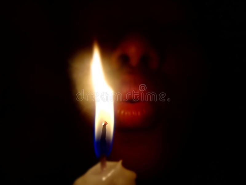 Blowing candles in the dark room that Blackout day or birthday. Photo stock photography