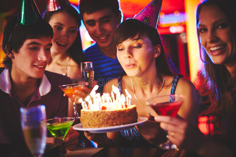 Blowing candles stock photography