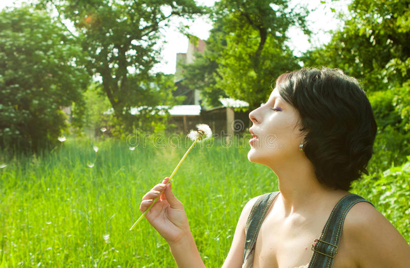 Download Blowing dandelion stock image. Image of blowing, woman - 14712381