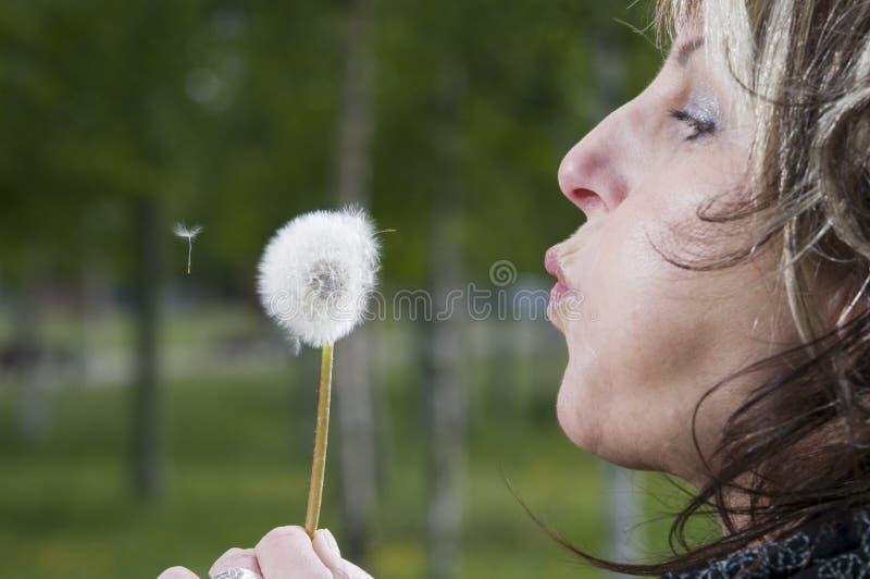 Blowing for dandelion