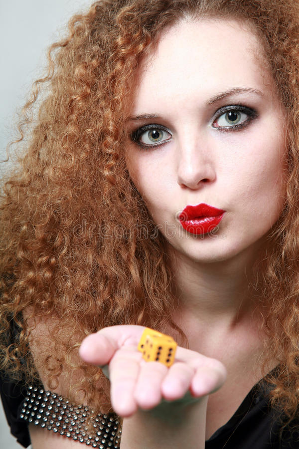 Download Blowing On Dice For Good Luck Stock Image - Image: 25102393