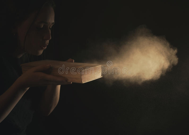Blowing dust off Bible royalty free stock photography