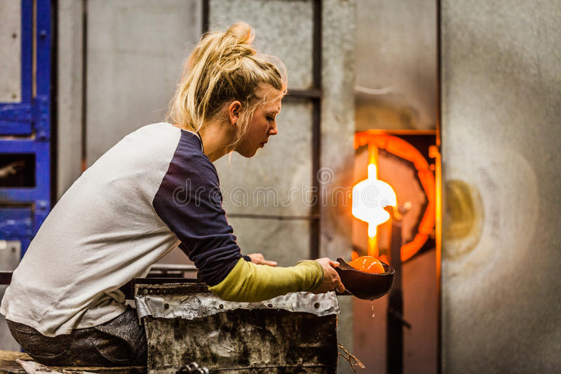 Blowing Glass Professional Woman Working on a Vase. royalty free stock photos