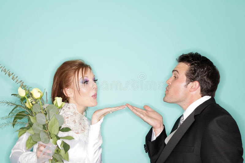 Blowing kisses stock photography