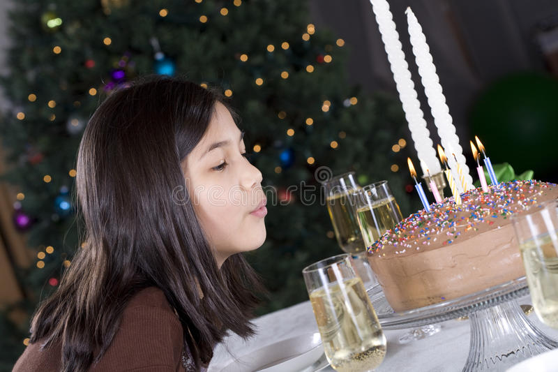 Blowing out birthday cake candles stock image
