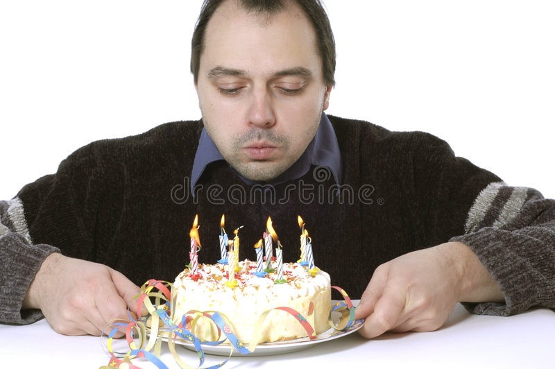 Blowing out the candles. Man is blowing out the candles stock photography