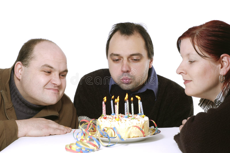 Blowing out the candles stock photo