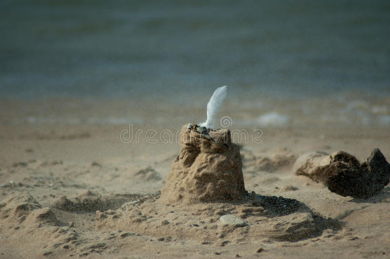 blowing sand castle stock images