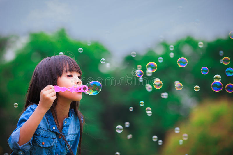 Download Blowing a soap bubbles stock photo. Image of cute, green - 24415562