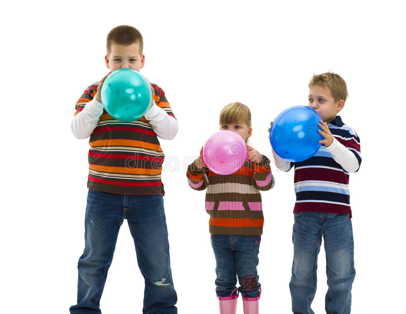 Blowing up toy balloons stock image