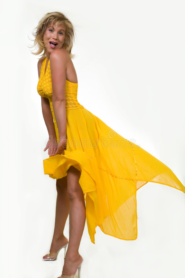 Blowing yellow dress stock images