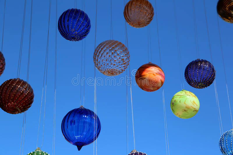 Blown glassware. Suspended colorful circular blown glassware stock photos