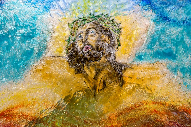 Blown multi color Glass of Jesus Christ. Ideal for concepts and backgrounds stock photos