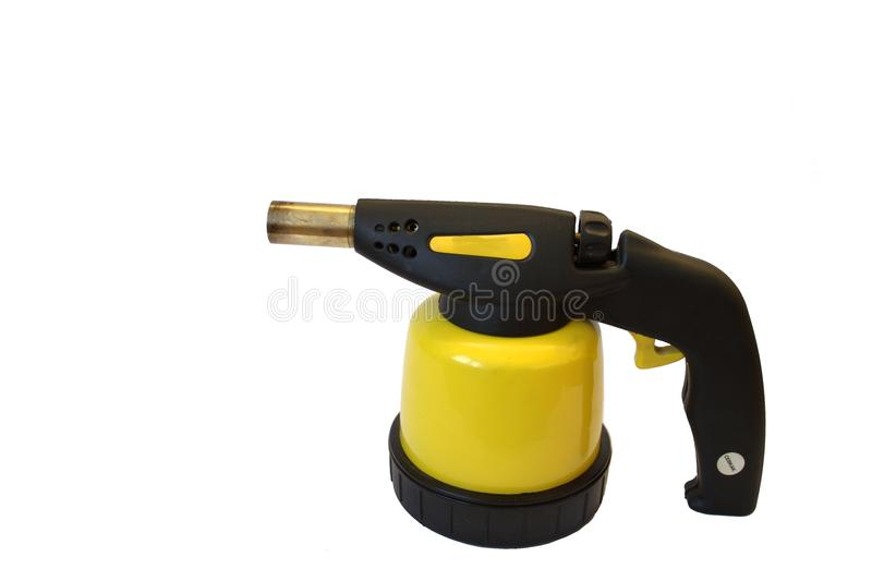 Blowtorch isolated yellow. Isolated yellow gas blowtorch with piezo for soldering and heating royalty free stock photos