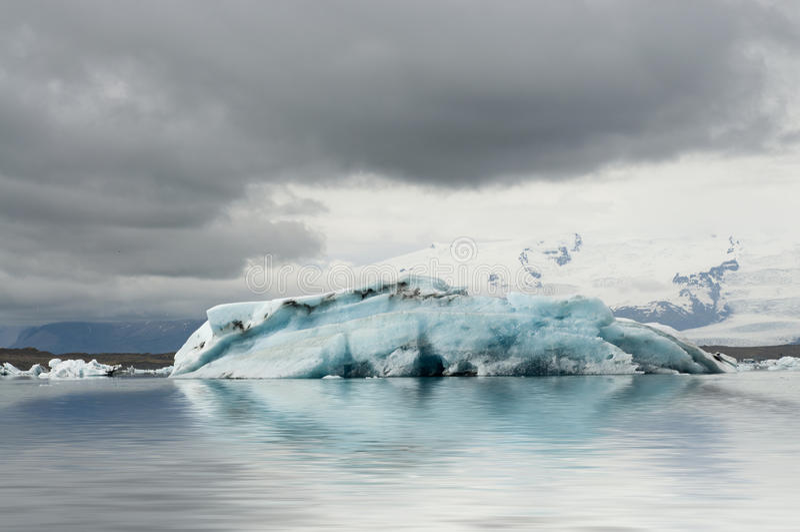 Blu iceberg in the glacier lagoon stock photo