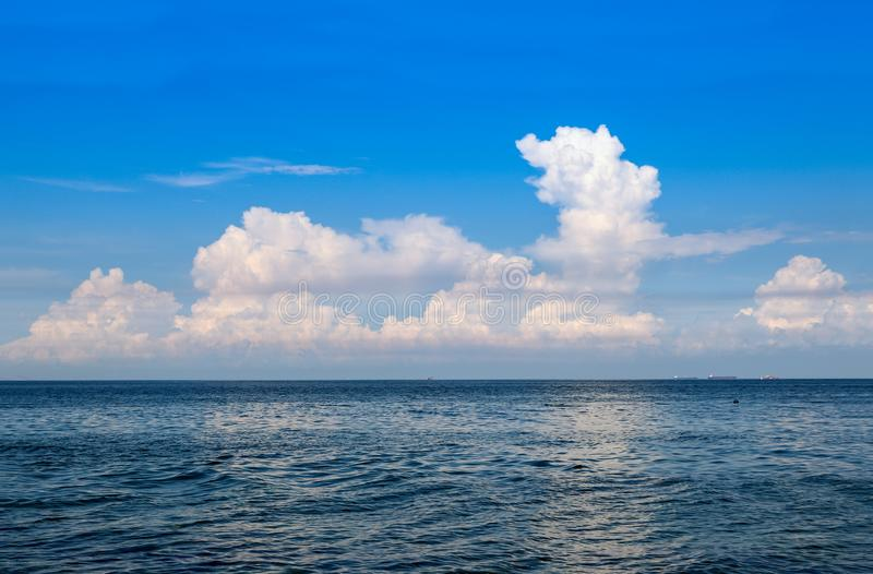 Blue​ sky​ with​ Blue​ sea​ and​ white​ clouds​. Blue​ sky​ with​ Blue​ sea stock images