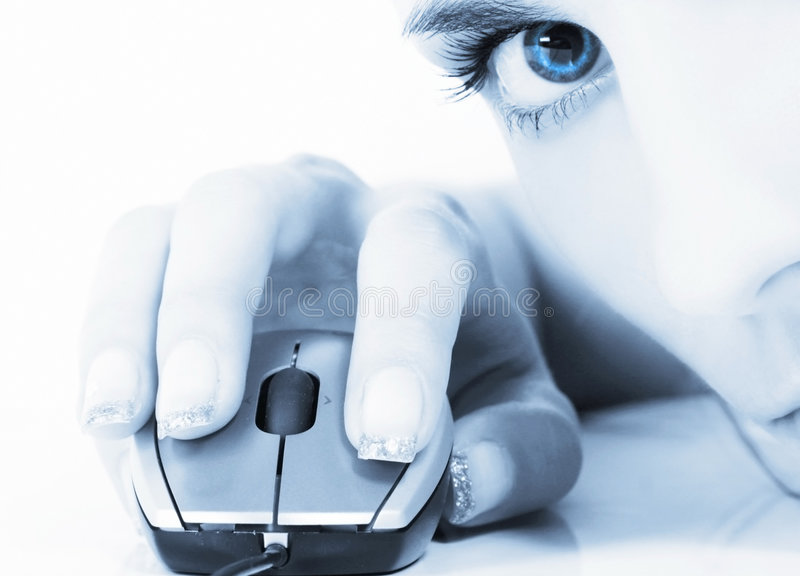 Blue. Young woman holding computer's mouse
