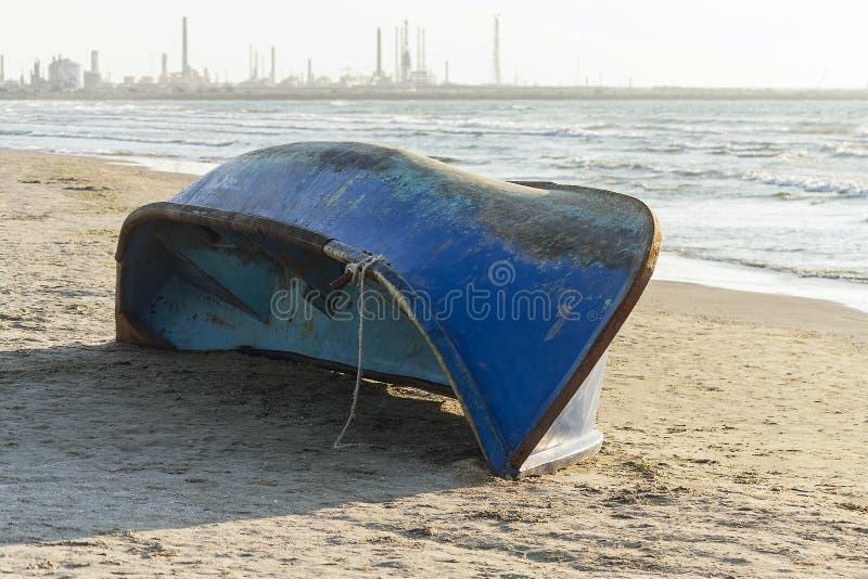 Blue abandoned boat royalty free stock photo