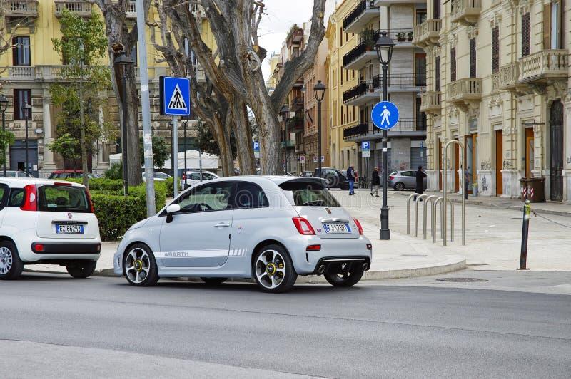 Blue Abarth 595 parked in Lungomare Nazario Sauro seafront promenade. Bari. Apulia or Puglia. Italy. BARI, ITALY - APRIL 1, 2018: Blue Fiat 500 parked in stock image