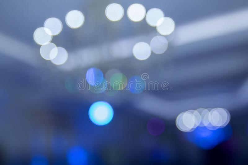 Blue lights background . Blue abstract background . Blue and purple bokeh glitter vintage lights background defocused royalty free stock image
