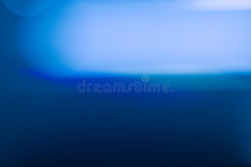 Blue abstract light background with smooth lines stock photography