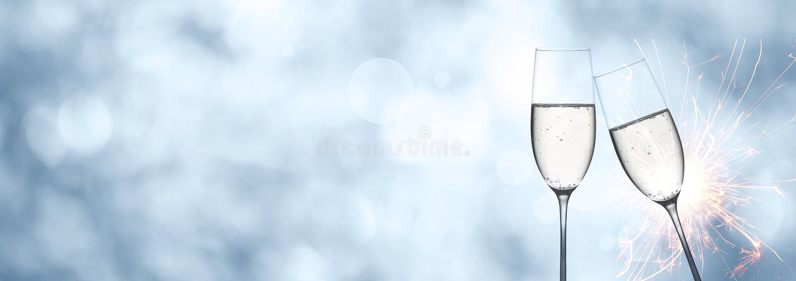 Abstract winter background with champagne and sparkler stock image