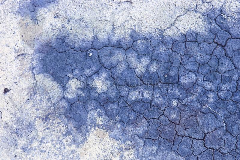 Blue aged cracked salted soil, craquelure effect. Pattern of blue aged cracked salted soil, craquelure effect in high resolution royalty free stock photo