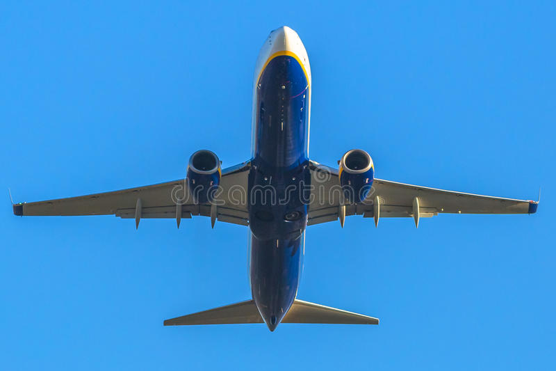 Blue airplane takeing off stock image