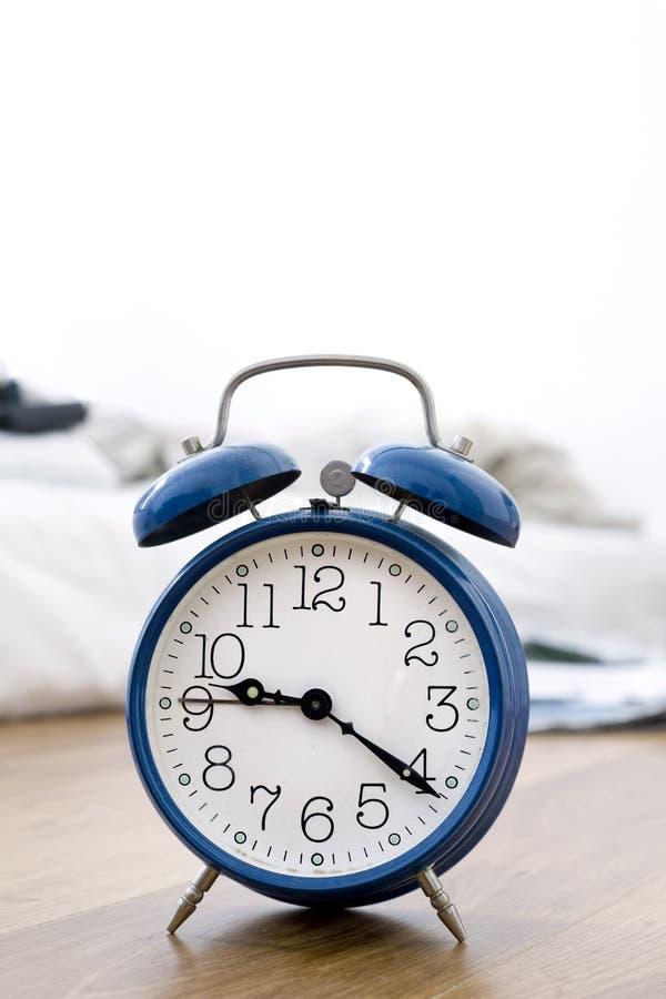 Blue alarm clock royalty free stock photography