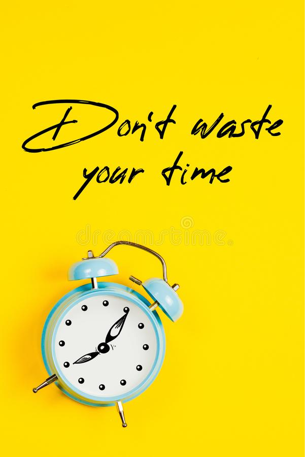 Blue alarm clock with graphics and text Don`t waste your time royalty free stock photography