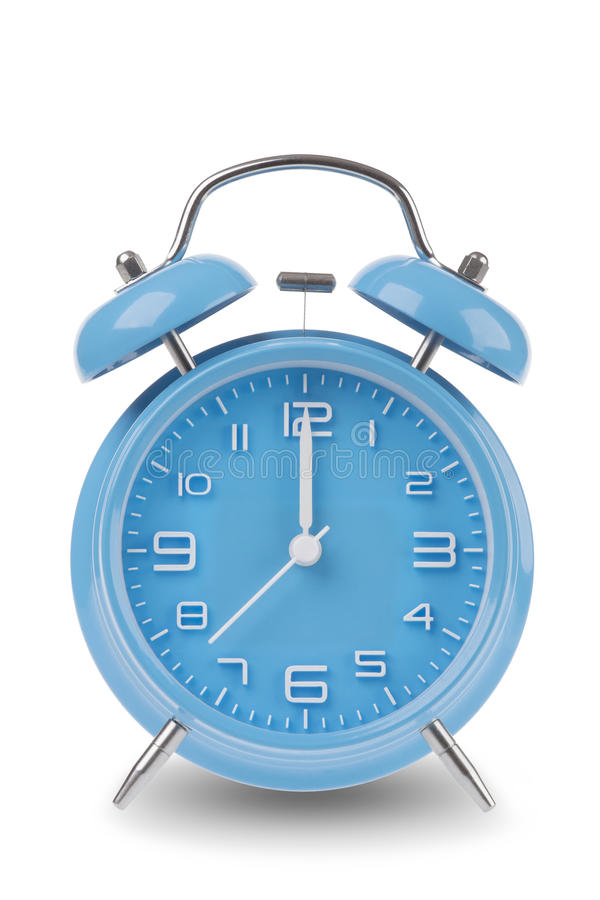 Blue alarm clock with the hands at 12 am or pm midnight or noon isolated on a white background royalty free stock photo