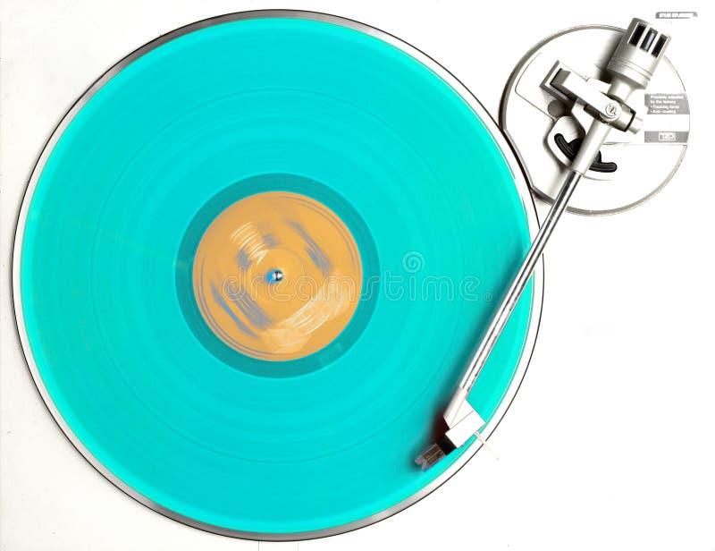 The blue album. Blu vinyl album turning on turntable royalty free stock image