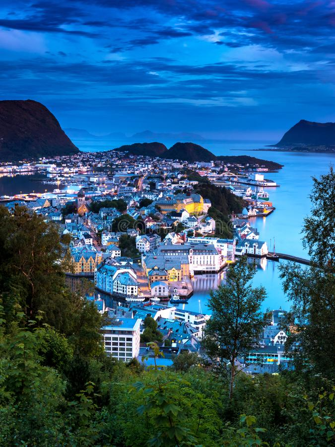 Cityscape with Aerial View of Alesund Center in The Evening. Image of Alesund after midnight in Summer taken from Mount Aksla Viewpoint. Alesund is a port town royalty free stock image