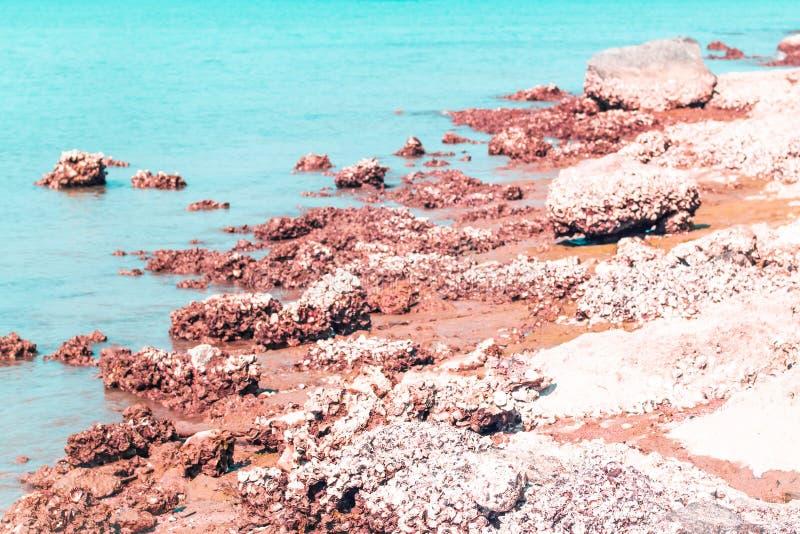 Blue amazing azure coloured sea water with granite rocks in Prachubkeereekhan Thailand royalty free stock photos